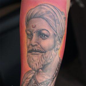Red Indian Tattoo Done by Mahesh Ogania at laksh Tattoo Goa India.